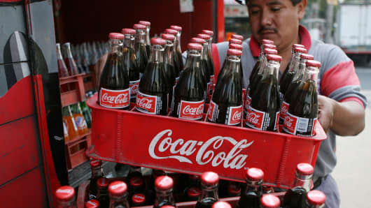 A Coca-Cola employee distributes Coca-Cola soda bottles in Mexico City.