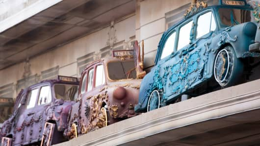 Multicolored decorated sections of London taxi cabs sit above the front windows of J.Crew Group's new store on Regent Street in London.