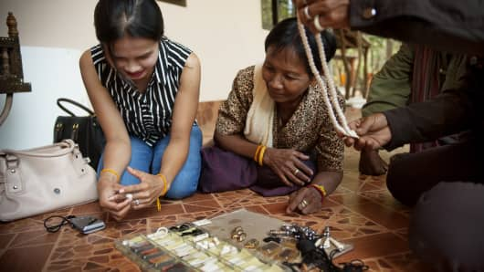 A women sells ivory jewelry in a local temple of the Surin province, Thailand.