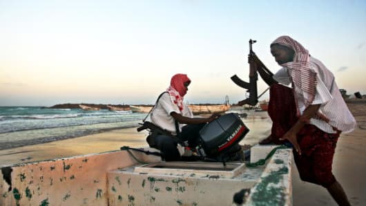 Armed Somali pirates carrying out preparations to a skiff in northeastern Somalia, ahead of new attacks on ships sailing in the Gulf of Aden in January 2010.