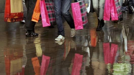UK shoppers carry Topshop bags on Oxford Street in London, England.