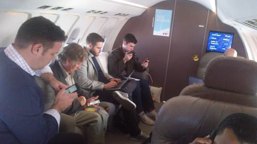 People testing Gog's new text and talk in-flight service.