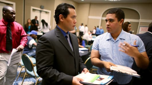 Job recruiter (R), speaks to Daniel Laminitis as he looks for work during the Choice Career Fair on November 7, 2013 in West Palm Beach, Florida.