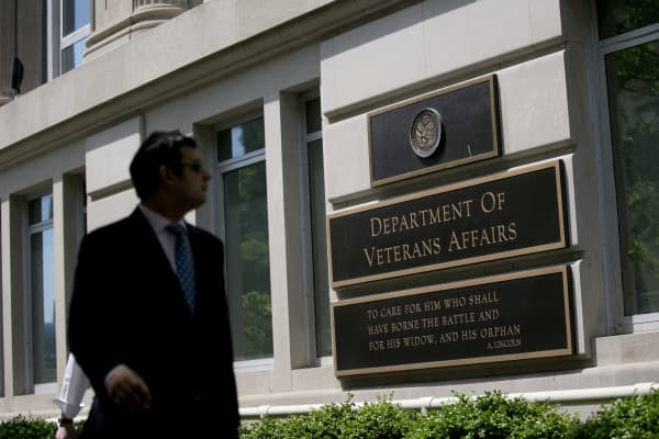 A pedestrian walks past the U.S. Department of Veterans Affairs (VA) headquarters in Washington, D.C.