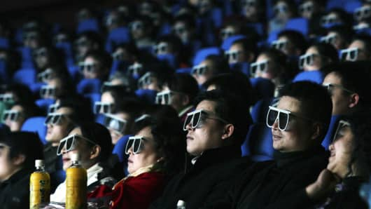 Audience members watch a movie through 3D glasse at an IMAX theatre in Wuhan of Hubei Province, China.