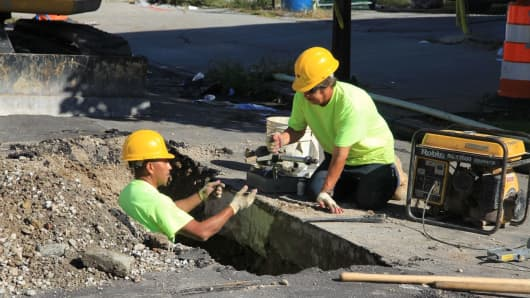A construction crew fixes aging water pipes in Baltimore.