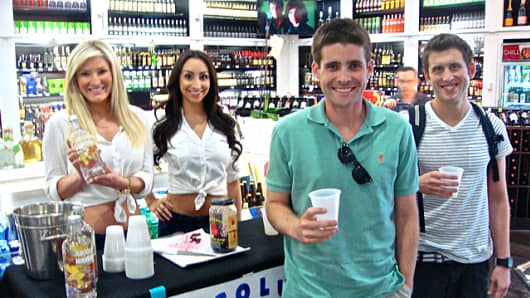 Passengers sampling liquor at the Liquor Library at baggage claim at McCarren International Airport in Las Vegas.
