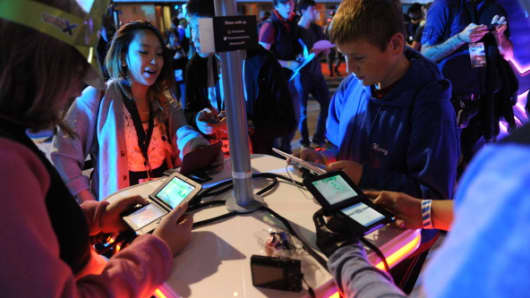 Attendees play the new Pokemon X and Pokemon Y video games on the Nintendo Co. 3DS at a launch event in New York, U.S., on Friday, Oct. 11, 2013.