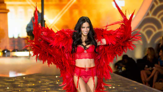 Model Adriana Lima walks the runway at the 2013 Victoria's Secret Fashion Show.