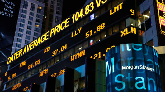 File Photo: Nighttime view of the neon financial ticker on the Morgan Stanley headquarters.