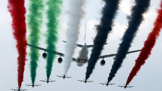United Arab Emirates' Air Force Aerobatic Team performs with an Emirates Airline Airbus A380 at the Dubai Airshow on November 18, 2013, in Dubai.