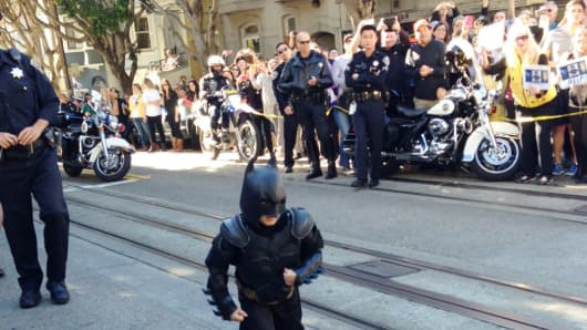 "The photo President Obama tweeted of Miles, aka BatKid, ""saving Gotham."""