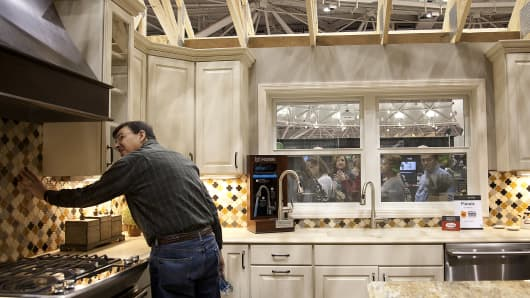 An attendee views a kitchen renovation at the Home and Garden Show in Minneapolis.