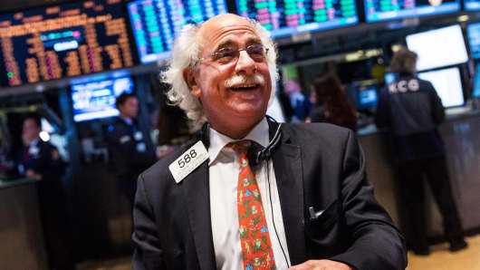 A trader works on the floor of the New York Stock Exchange on November 18, 2013 in New York City.