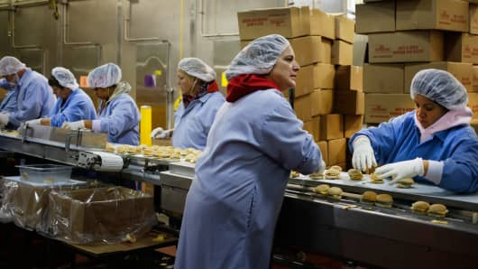 Workers assemble pork sausage sandwiches at the Purnell Sausage Co. factory in Simpsonville, Kentucky, Nov. 15, 2013.