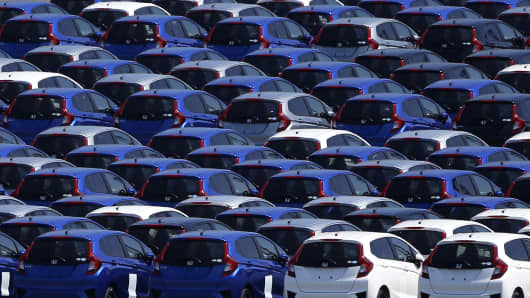 Honda Motor vehicles bound for shipment sit parked at a port in Yokohama, Kanagawa Prefecture, Japan.