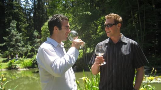 Santa Cruz Experience CEO Austin Twohig, (left) and his employee Dave Solomon testing wine.