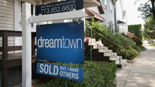 A sold sign is displayed in front of a home in Chicago, Illinois.