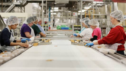 Employees sort Bordeaux cookies for packing at the Pepperidge Farm Inc. manufacturing facility in Richmond, Utah.