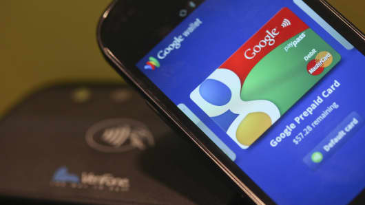 The Google Mobile Wallet application for cardless payments is displayed on a smartphone screen at the Mobile World Congress in Barcelona, Spain, Feb. 29, 2012.