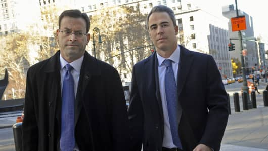 Michael Steinberg, a portfolio manager with SAC Capital Advisors LP, right, arrives at federal court with attorney Barry Berke in New York on Tuesday, Nov. 19, 2013.