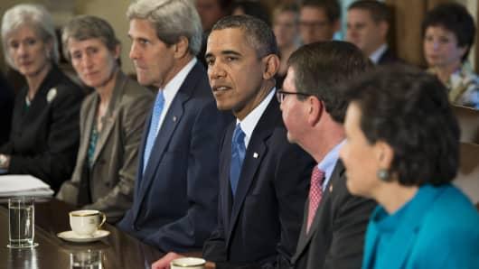 President Barack presides over a Cabinet meeting on Sept. 30, 2013.