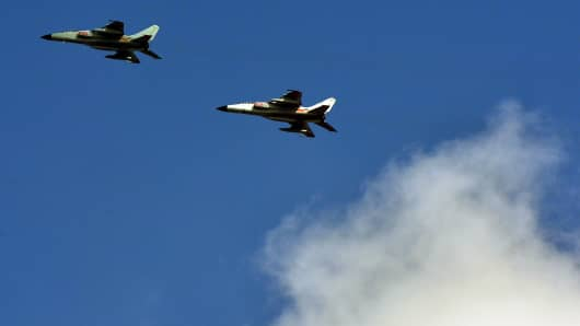 Photo taken on October 23, 2013 shows Chinese People's Liberation Army fighter jets leaving their base in Shanghai.