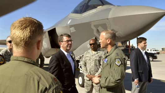 Ashton 'Ash' Carter, in black at left, plans to step down as United States deputy secretary of defense.