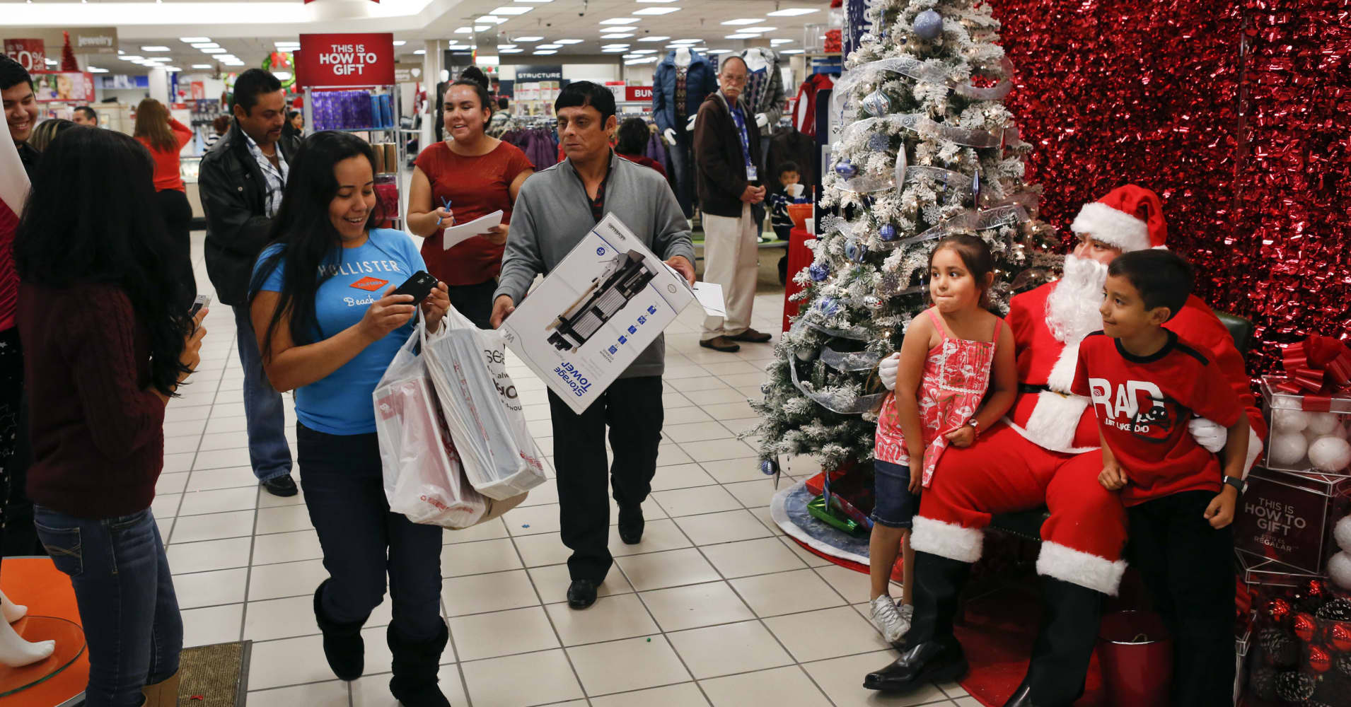 Holiday shoppers plan to spend less, buy gift cards