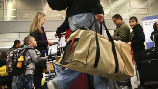 Travelers check in for holiday flights at Chicago's O'Hare International Airport on Wednesday.
