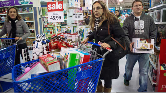 Shoppers wait in line during on Thanksgiving 2013 at the Toys 'R Us store in Fairfax, Va.