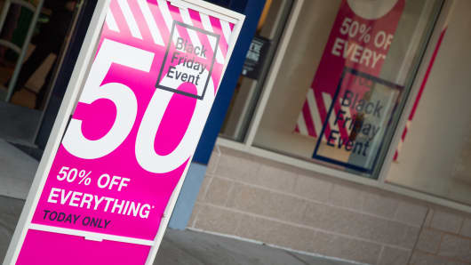 A sign displaying Black Friday discounts at The Gap on Nov. 29, 2013.