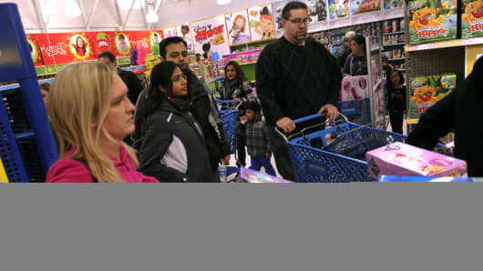 A traffic jam of shoppers and carts clogged the aisles of the Toys R Us store on County Line Road in Arapahoe County Thursday night, November 28, 2013.