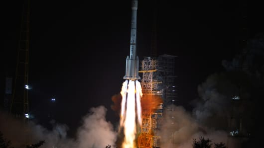 A rocket carrying China's Chang'e-3 lunar probe takes off from the Xichang Satellite Launch Center on December 2, 2013.