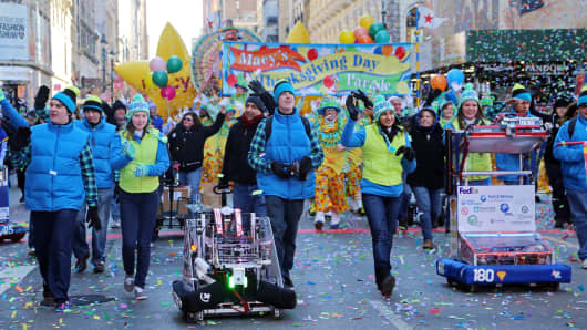 Students and their robots from the First Robotics program lead the Macy's Thanksgiving Day parade.