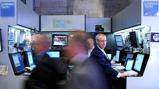 Traders work at the Goldman Sachs Group Inc. booth on the floor of the New York Stock Exchange (NYSE) in New York.
