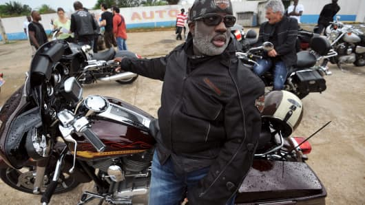 Members of the Elephant's Bikers club gather on November 15, 2013, in San-Pédro, a port town in the Ivory Coast. This Ivorian biker club was created 10 years ago to commemorate Harley-Davidson's centenary.