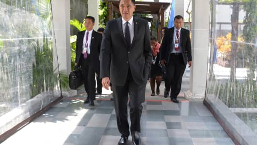 Indonesian Trade Minister Gita Wirjawan walks prior to a press conference in Bali on December 3, 2013
