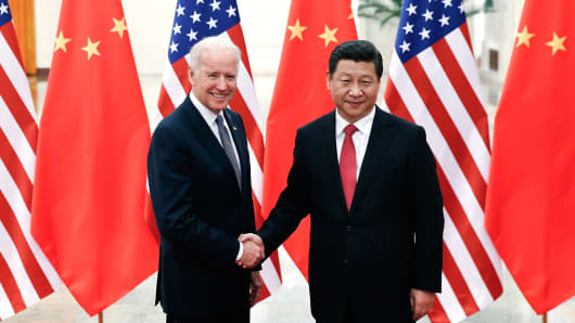 Chinese President Xi Jinping (R) shake hands with U.S Vice President Joe Biden (L) inside the Great Hall of the People on December 4, 2013 in Beijing, China.