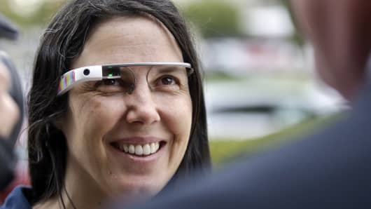 Cecilia Abadie wears her Google Glass as she talks with her attorney outside of traffic court Tuesday, Dec. 3, 2013, in San Diego.