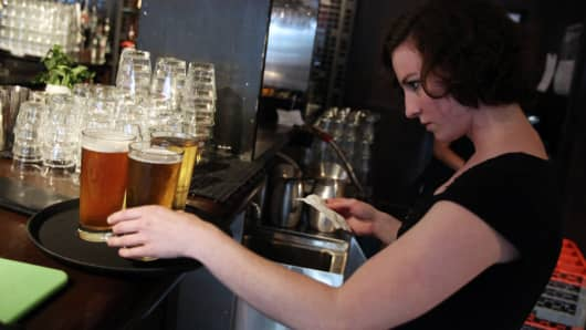 A waitress checks an order at Bar Louie restaurant in Chicago.