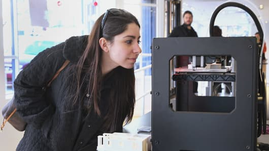 A woman took a closer look at the Replicator 2 at the new MakerBot 3D printer store in Boston.