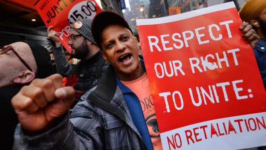 Demonstrators outside a McDonald's restaurant near New York's Times Square as part of a nationwide protest of fast food workers December 5, 2013.