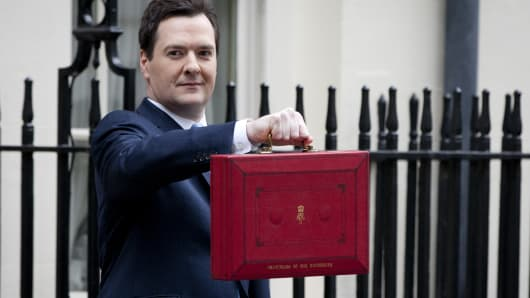 George Osborne, the Chancellor of the Exchequer, poses before presenting his annual budget to Parliament, outside 11 Downing Street on March 20, 2013 in London, England.