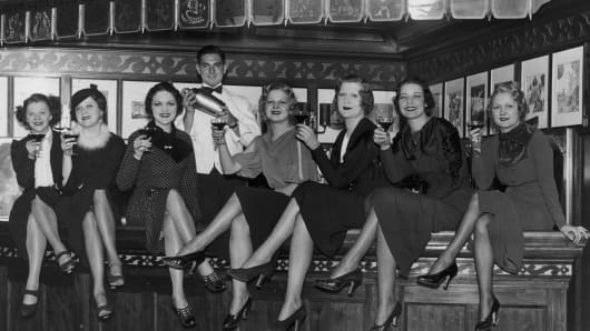 A group of young women at the bar on board the luxury liner SS Manhattan, off New York, 5th December 1933.