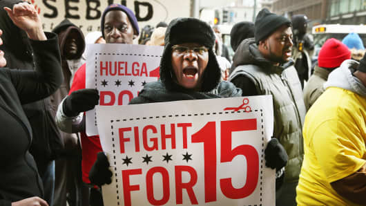 Fast-food and retail workers protest for higher wages outside a Sears store on December 5, 2013 in Chicago.