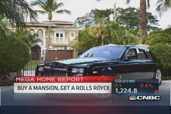Buy a mansion, get a Rolls Royce