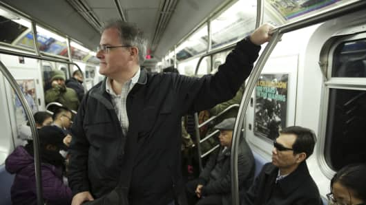 Tom Weppler, who obtained a letter from the Metropolitan Transportation Authority excusing him from a delay, rides a train in New York, Nov. 27, 2013.