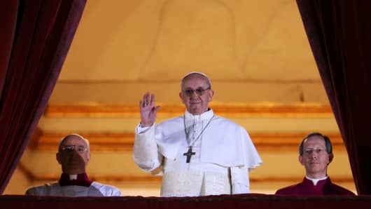 The newly elected Pope Francis I appears on the central balcony of St Peter's Basilica on March 13, 2013.
