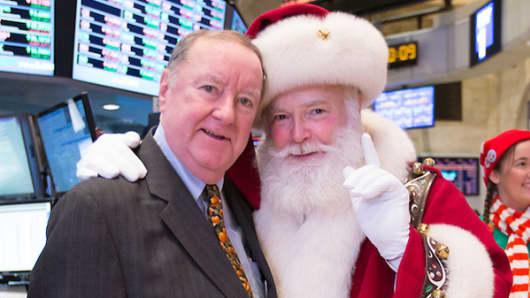 Art Cashin poses with Santa Claus at the NYSE.